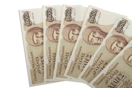 greek currency: Old Greek currency of 1000 drachmas bills isolated on white.