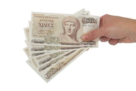 savings and loan crisis: Old Greek currency of 1000 drachmas bills isolated on white.