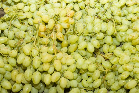 super fruit: Juicy health booster power health fruit freshly cut white grapes on an open air fruit market stand.