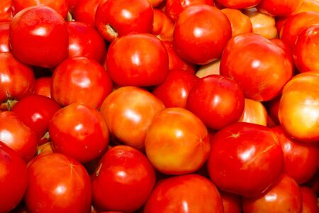 super fruit: Juicy health booster power health vegetable freshly harvested tomatoes on an open air fruit market stand. Stock Photo