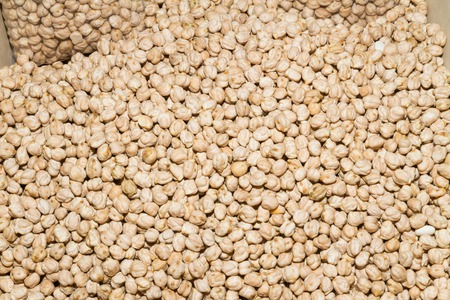 booster: Nutritious health booster high protein high energy food a heap of dry chickpeas on an open air food market bazaar.
