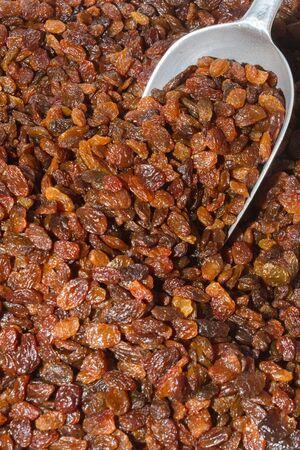booster: Nutritious health booster high protein high energy food a heap of sun raisins on an open air food market bazaar.