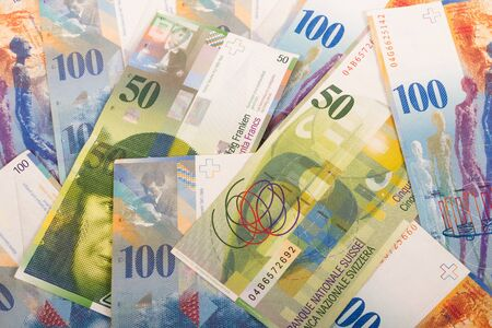 swiss franc note: Swiss banknotes of 100 and 50 CHF bills Stock Photo