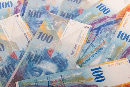 swiss franc note: Swiss banknotes of 100 CHF bills Stock Photo