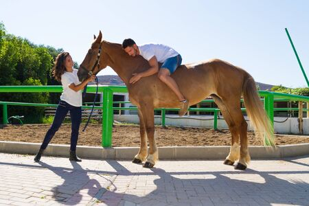 horse love horse kiss animal love: Young couple and their best friend brown-blond purebred mare in the riding club