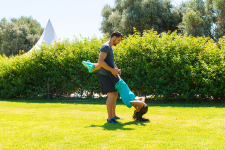 mascular: Athletic young couple doing fitness workout exercises on a summer day at the park. Healthy lifestyle, and fitness concept. Stock Photo