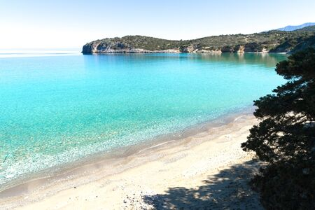 crystal clear: Beautiful idyllic crystal clear turquoise waters bay with pebble and sand beach in Crete, Greece.