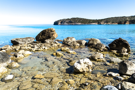 crystal clear: Beautiful crystal clear turquoise waters coast with small pebble stones and rocks, Grete Greece. Stock Photo