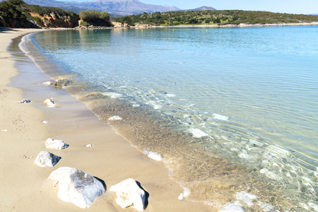 crystal clear: Beautiful idyllic crystal clear turquoise waters shoreline beach with sand and pebbles, Crete Greece.