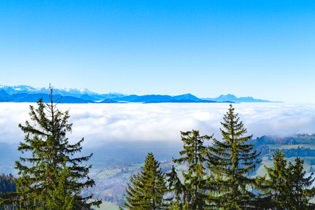 swiss alps: Unique panoramic skyline cloudscape view of Swiss Alps in blue sky, towering over Zurichsee - Obersee, Zurich region.