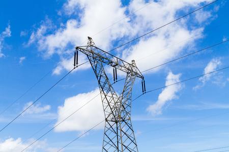 megawatt: Steel pylon with high voltage electric energy distribution powerlines.