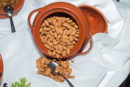 booster: High protein high energy health booster food, fresh crispy almond flesh seeds on a table.