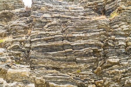 layered: Layered folded rocks formation on southern Crete coast, Greece Stock Photo