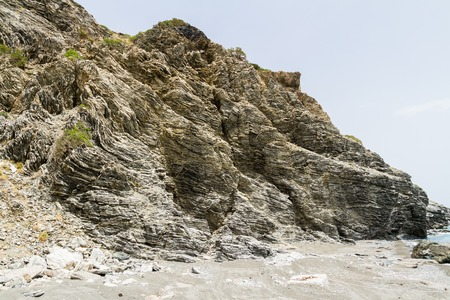 ductile: Layered folded rocks formation on southern Crete coast, Greece Stock Photo