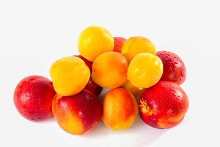Apricots, nectarines super fruit, high energy antioxidant food, health booster. Juicy meiterranean apricots and nectarines isolated on white background.
