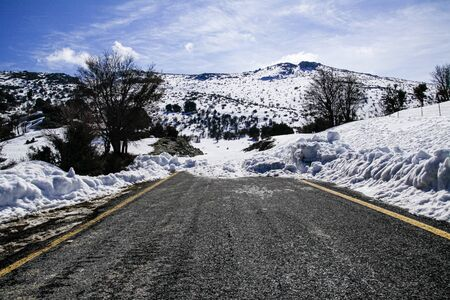 High mountains road winter wonderland tour, steep slopes, snow-capped rocky peaks for hiking trekking adventure recreation in Heraklion Crete, Greece. Banco de Imagens