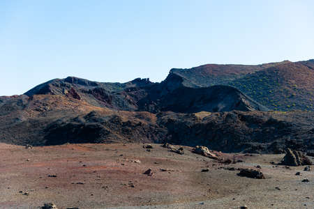 Unique panoramic view of spectacular lava river flows from a huge volcano crater, creates a lunar landscape on planet earth. Mountains of fire, Timanfaya National Park, Lanzarote, Canary Islands, Spain.