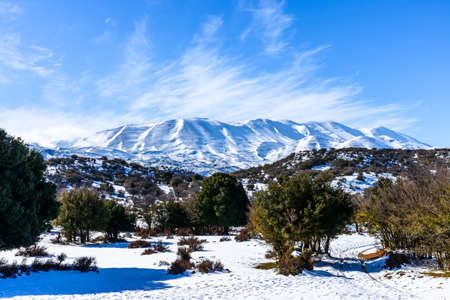 High mountains road wonderland tour, steep slopes, snow-capped rocky peaks for hiking adventure recreation in Crete, Greece.
