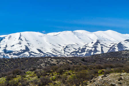 Mountains wilderness, stunning steep slopes, cliffs and snow-capped rocky peaks