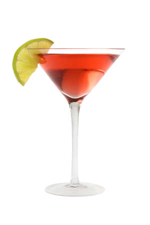 Cosmopolitan mixed drink with lime wedge on a white background photo