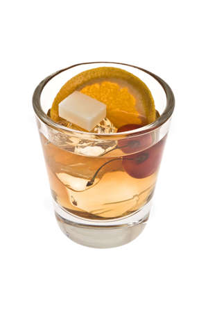 Old fashioned mixed drink with sugar cube on a white background photo