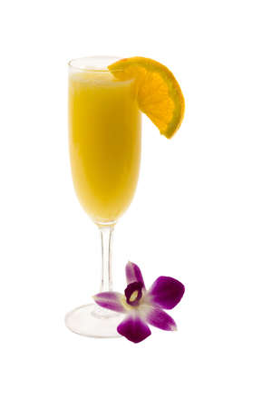 mimosa: Mimosa mixed drink with orange slice and orchid garnish on a white background
