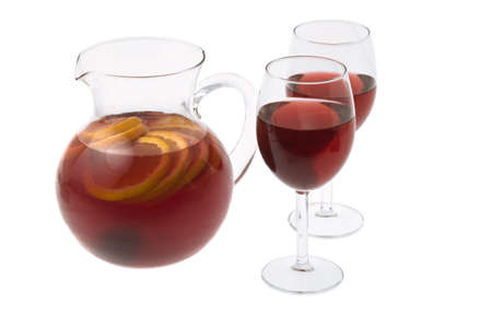 Red Wine Sangria in pitcher with stemware on white background Фото со стока