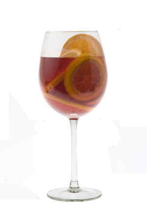 Red Wine Sangria in stemware on white background Фото со стока