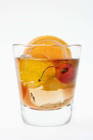 Old fashioned mixed drink on a white background