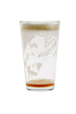 empty: Empty pint glass with foam on white background Stock Photo