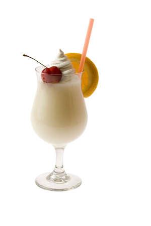 Pina Colada mixed drink with fruit garnish on white background photo