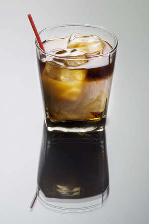 white russian: White Russian mixed drink on a grey background with reflection