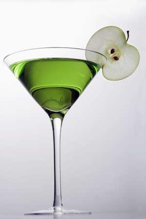 Apple Martini mixed drink with apple slice garnish on grey background Stock Photo - 6390731