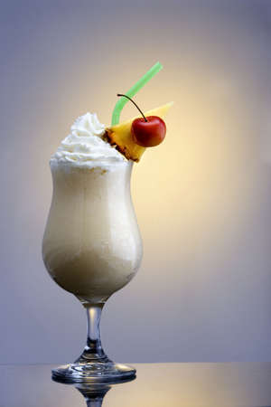 colada: Pina Colada mixed drink on plain background with reflection