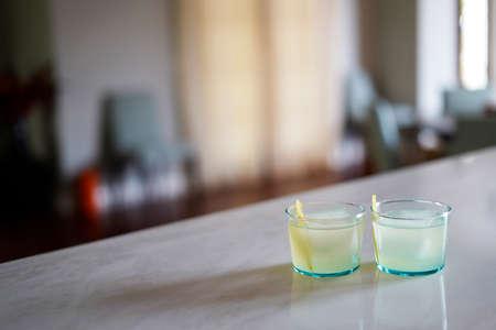 Vodka Elderberry Cocktail in short glasses served with a lemon twist