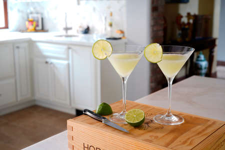 Vodka Lime Coconut Martini Cocktail in a plush posh kitchen with marble from Namibia