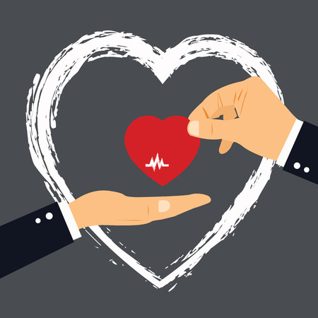 Concept of Donate Organ, heart in a hand symbol in red color