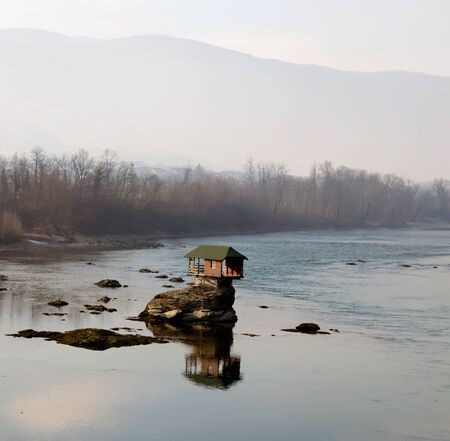 sinking: House on river Drina Stock Photo