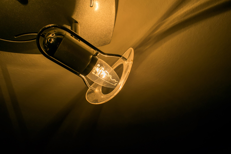 electric fixture: dim light on the ceiling Stock Photo