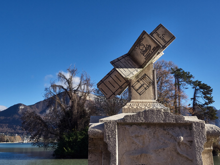 Annecy, France - December 07, 2018: Shot of a monument in the Gardens Of Europe. The shot is taken during a beautiful sunny day Standard-Bild - 117735408