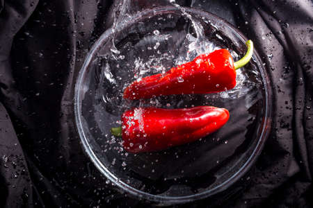 red peppers: two red peppers splashing
