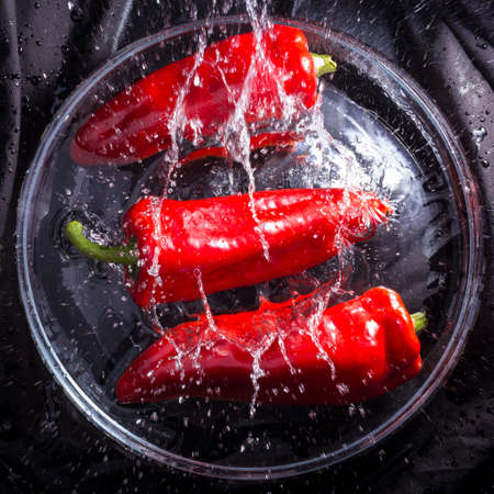 red peppers: red peppers splashing Stock Photo