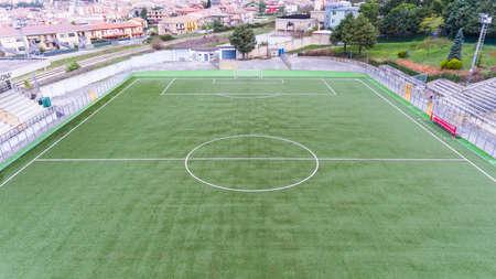birds eye: aerial drone birds eye view of football field in basilicata