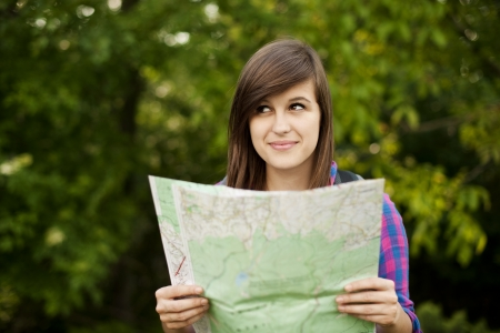 Beautiful young woman holding a map photo