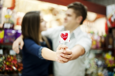 Couple holding lollipop in their hands photo