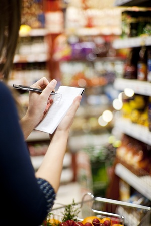 supermarket cart: Shopping list Stock Photo