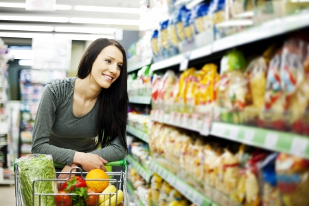supermarket shopping: Woman at groceries store
