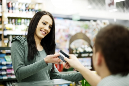 supermarket cash: Paying credit card for purchases Stock Photo