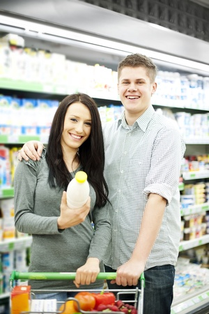 Young couple shopping at supermarket Stock Photo - 18161978