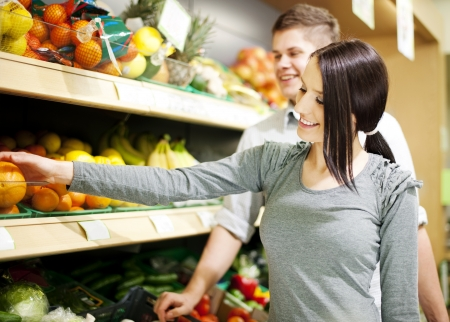 Young couple shopping at groceries photo